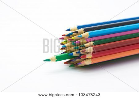 Multiple colour wooden pencils on white background
