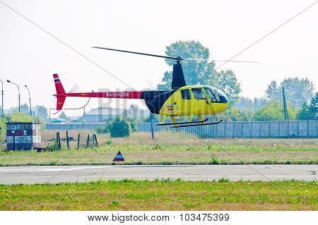 Pilot of Robinson R44 Raven on airshow