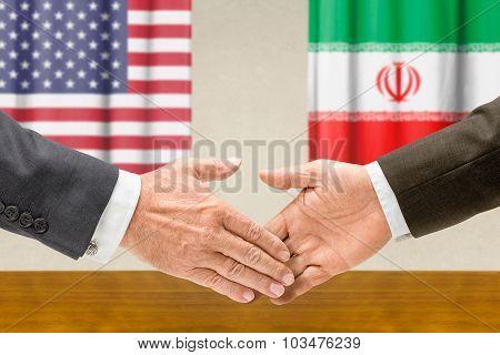 Representatives Of The Usa And Iran Shake Hands