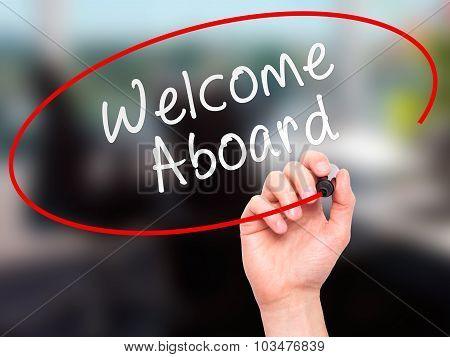 Man hand writing Welcome Aboard on visual screen.