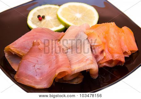 Trio of smoked fish on plate close up