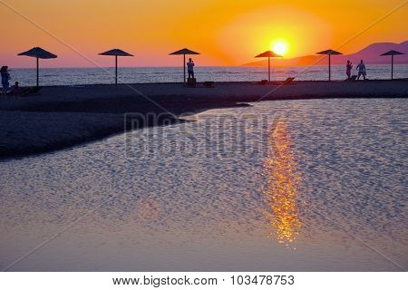 sunset on beach umbrella of Ada Bojana island, Montenegro