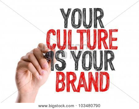 Hand with marker writing: Your Culture Is Your Brand