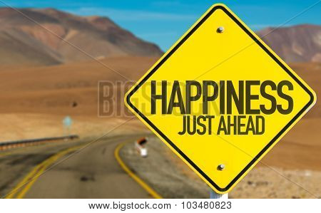 Happiness Just Ahead sign on desert road