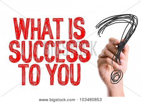 Hand with marker writing: What Is Success To You?