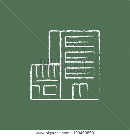 Hotel building hand drawn in chalk on a blackboard vector white icon isolated on a green background.