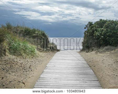 Beach with boardwalk sea and sky