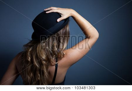 Sexy Woman Standing Back Wears A Hat On Head