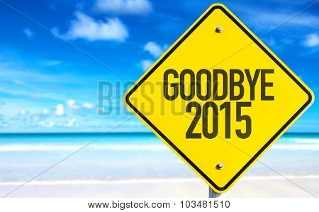 Goodbye 2015 sign with beach background
