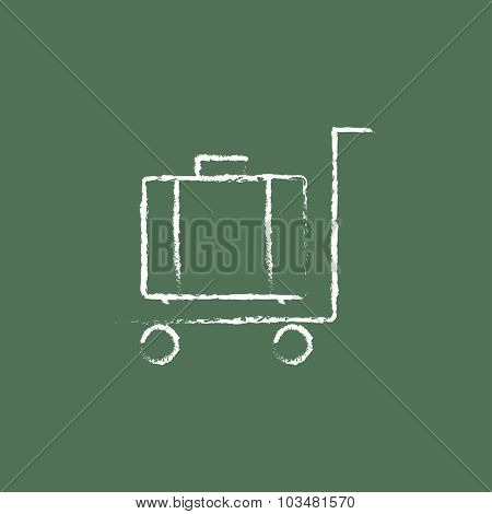 Luggage on a trolley hand drawn in chalk on a blackboard vector white icon isolated on a green background.