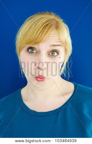 Portrait Of Young Blond Woman Blowing A Kiss