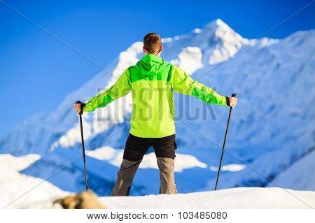Man hiker trekking in high Himalaya Mountains in Nepal. Happy hiking climbing in white winter or aut
