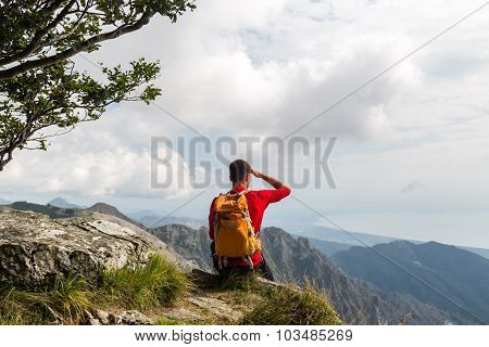 Hiker In Mountains Looking At View