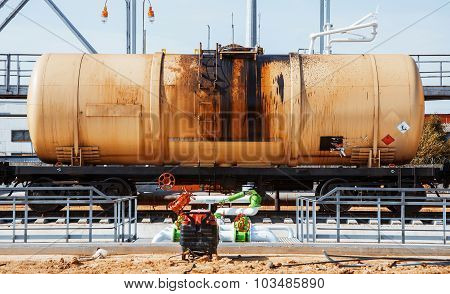 Railroad train of black tanker cars