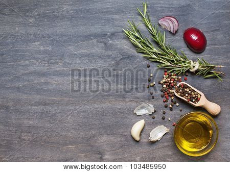 Bunch Of Rosemary, Condiment And Olive Oil On The Wooden Background