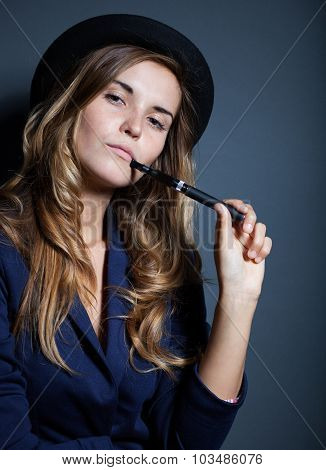 Elegant Woman Holding And Smoking E Cigarette