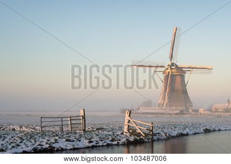 Winter Landscape In The Netherlands With A Windmill