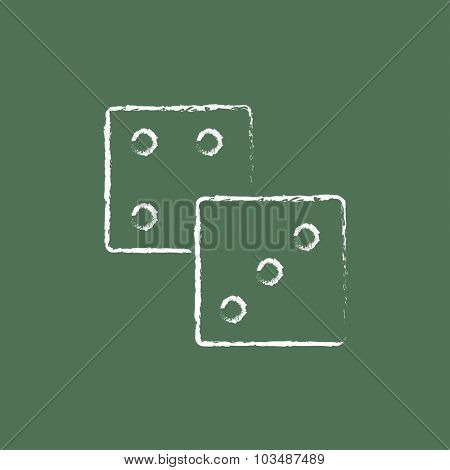 Dices hand drawn in chalk on a blackboard vector white icon isolated on a green background.