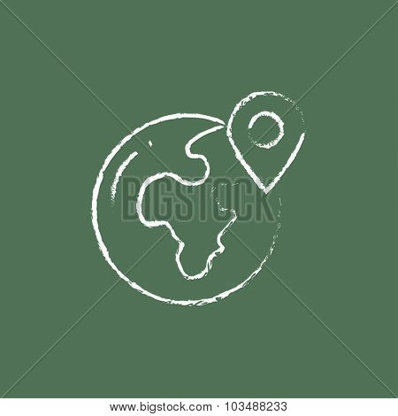 Globe with pointer hand drawn in chalk on a blackboard vector white icon isolated on a green background.