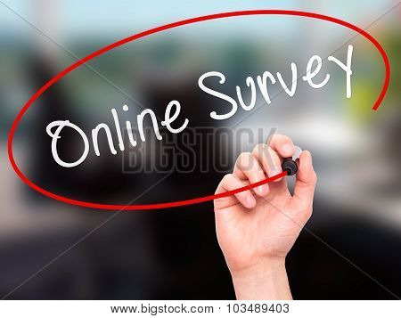 Man hand writing Online Survey on visual screen.
