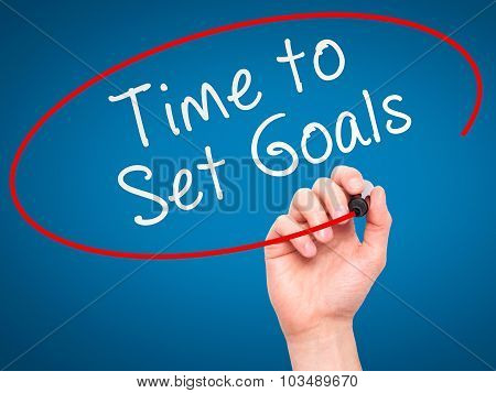 Man hand writing Time to Set Goals on visual screen.