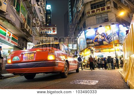 Red Taxi Cab At The Crossroad With Carnavon Road And Prat Ave Near Nathan Road in Hong Kong