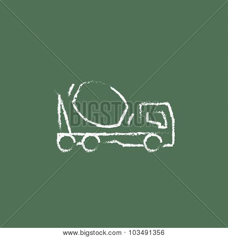 Concrete mixer truck hand drawn in chalk on a blackboard vector white icon isolated on a green background.