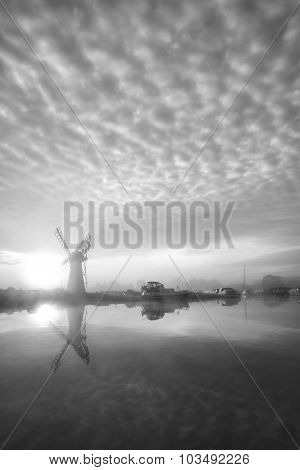 Stunnnig Landscape Of Windmill And River At Dawn In Black And White