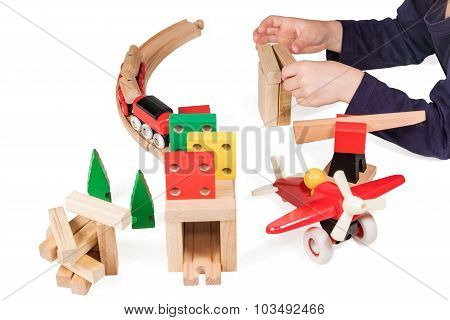 Child Hand Playing Wooden Toys