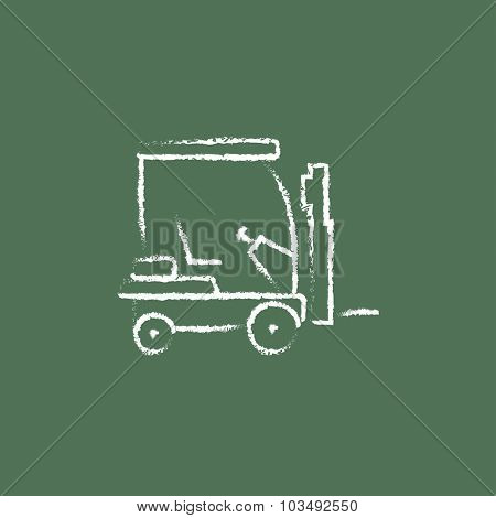 Forklift sketch icon hand drawn in chalk on a blackboard vector white icon isolated on a green background.