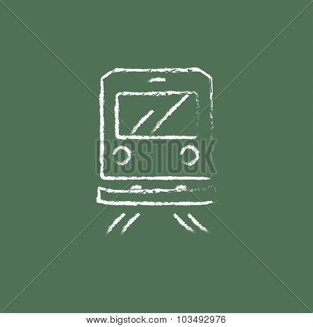 Back view of train hand drawn in chalk on a blackboard vector white icon isolated on a green background.