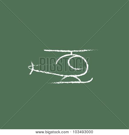 Helicopter hand drawn in chalk on a blackboard vector white icon isolated on a green background.