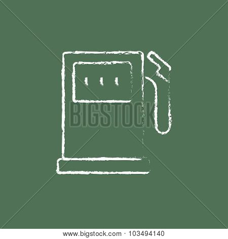 Gas station hand drawn in chalk on a blackboard vector white icon isolated on a green background.