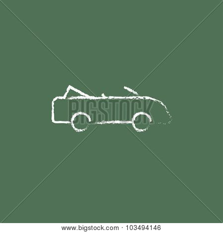 Convertible car hand drawn in chalk on a blackboard vector white icon isolated on a green background.