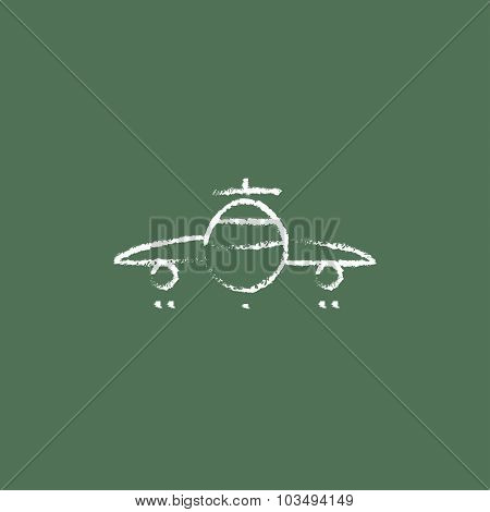 Airplane hand drawn in chalk on a blackboard vector white icon isolated on a green background.