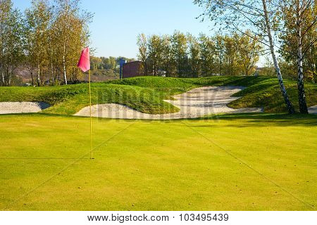 Green Of Golf Course With Cup And Bunkers