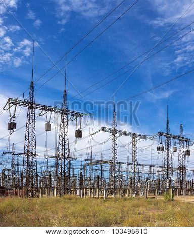 Distribution Electric Substation With Power Lines Against The Sky