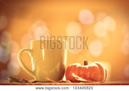 Pumpkin And Cup Of Coffee