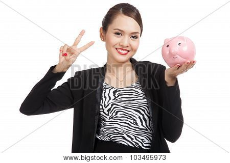 Asian Business Woman Show Victory Sign With Pig Coin Bank