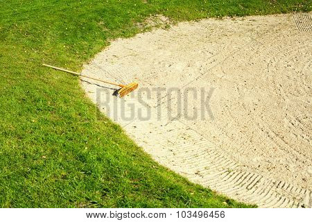 Sand Bunker On The Golf Course With Grass
