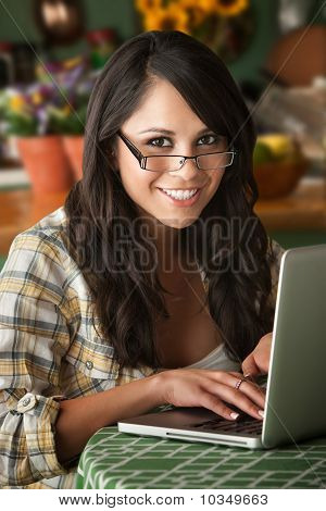 Beautiful Latina Woman With Computer