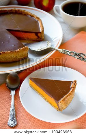 Homemade pumpkin pie with chocolate topping