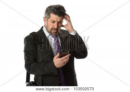 Hispanic businessman looking at cellphone with worried expression isolated over white bacgkround