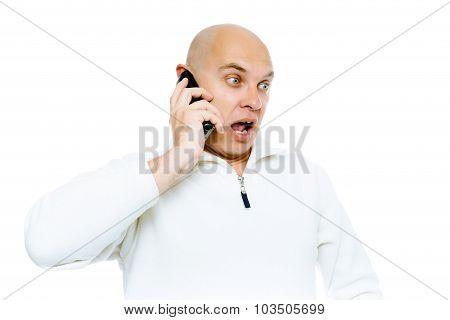 Bald Man Emotionally Communicates By Phone. Isolated. Studio