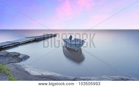 Small Boat And Jetty
