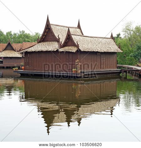 Thai Style Wooden House Along The Canal