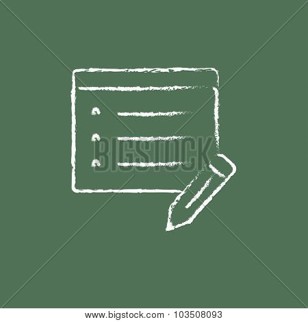 Notepad and pencil hand drawn in chalk on a blackboard vector white icon isolated on a green background.
