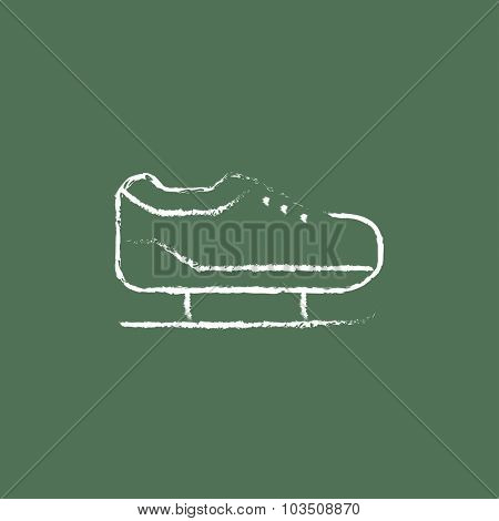 Skate hand drawn in chalk on a blackboard vector white icon isolated on a green background.