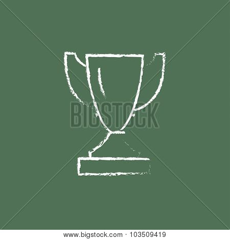 Trophy hand drawn in chalk on a blackboard vector white icon isolated on a green background.