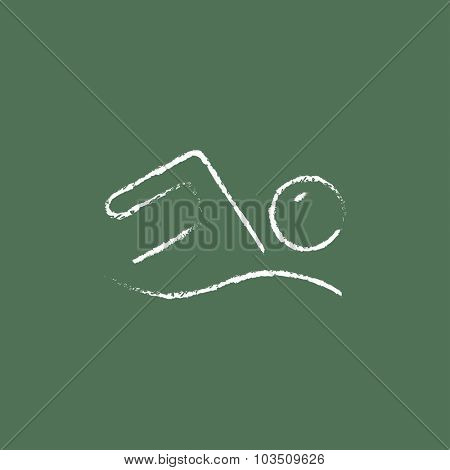 Swimmer hand drawn in chalk on a blackboard vector white icon isolated on a green background.